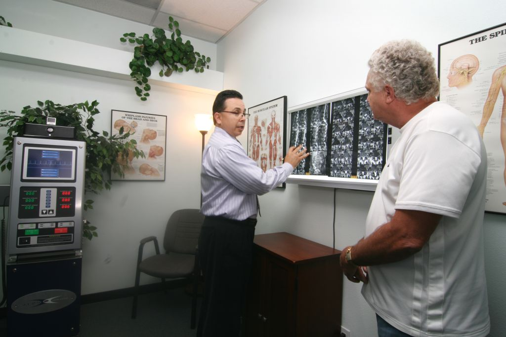 Dr. Brian A. Prieto showing X Rays to patient